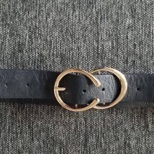 Black belt with gold circle buckle